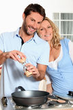 Husband cooking for wife Royalty Free Stock Image