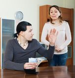 Husband counting money, woman watching Royalty Free Stock Image