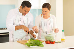 Husband cutting vegetables Royalty Free Stock Photo