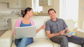 Husband denying credit card to wife online shopping stock footage