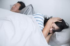 Husband disrupting wife`s sleep with his loud snoring Royalty Free Stock Images
