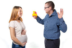 Husband with duch and pregnant wife Royalty Free Stock Image