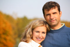 The husband embraces wife in autumn park Royalty Free Stock Photos