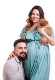 Husband embracing her pregnant wife Stock Photo