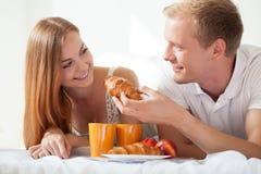 Husband feeding his wife Royalty Free Stock Image