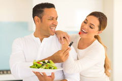 Husband feeding wife salad Stock Photo