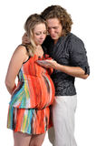 Husband feeds his pregnant wife, strawberries Stock Photography