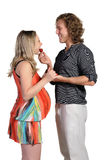 Husband feeds his pregnant wife, strawberries Royalty Free Stock Image