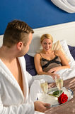 Husband flirting wife bedroom romantic evening celebration Royalty Free Stock Photo