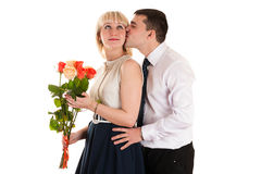 Husband gives wife flowers Royalty Free Stock Photo