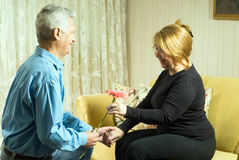 Husband Giving Flower To Wife - Horizontal Royalty Free Stock Photography