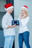 Husband giving his wife a Christmas gift Stock Photos