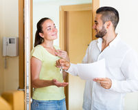 Husband giving the keys to apartment royalty free stock images