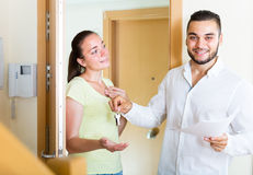 Husband giving the keys to apartment Stock Images