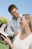 Husband Giving Present To Wife Stock Image