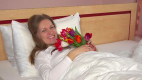 Husband hand give his happy wife bouquet of tulip flowers stock video