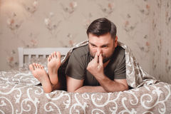 Husband has closed a nose with hand Stock Photos