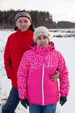 Husband and his wife in warm clothes stands together in winter forest Stock Images