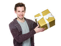 Husband hold a gift box for his wife Royalty Free Stock Photography