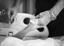 Grayscale Photography of Patient and Relative Holding Hands stock photos