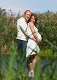 Husband holding pregnant wife Royalty Free Stock Photos