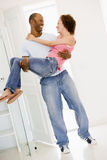 Husband holding wife in new home smiling Royalty Free Stock Image