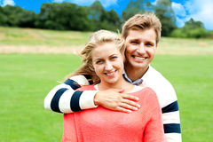 Husband hugging his wife from back Royalty Free Stock Images