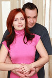 Husband hugging wife in house Royalty Free Stock Photos
