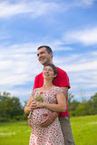 Husband hugs his pregnant Royalty Free Stock Photos