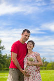 Husband hugs his pregnant wife Stock Images