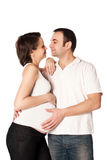 Husband hugs his pregnant wife, happy pregnancy. Stock Images