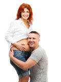 Husband hugs his pregnant wife Royalty Free Stock Photo