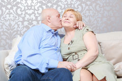 Husband kisses his wife Stock Photo