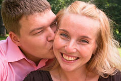 Husband kisses a wife Stock Images