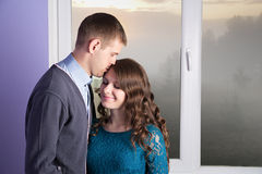 The husband is kissing his pregnant wife stock photography