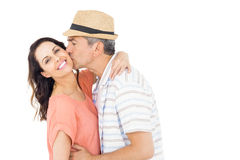 Husband kissing his wife on the cheek Royalty Free Stock Image