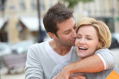 Husband kissing wife. In the street Royalty Free Stock Photo