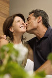 Husband kissing wife Royalty Free Stock Photos