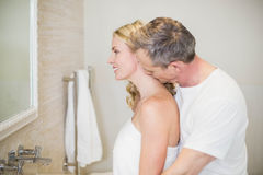 Husband kissing wife on the neck Royalty Free Stock Images