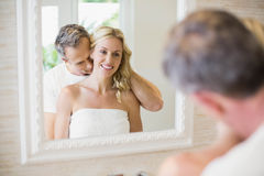 Husband kissing wife on the neck Stock Photography