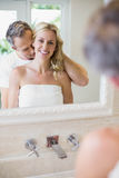 Husband kissing wife on the neck Stock Images