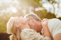 Husband kissing wife on the neck Royalty Free Stock Photos