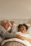 Husband laying next to his wife Royalty Free Stock Photo