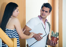 Husband leaving woman with luggage Royalty Free Stock Photography