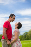 Husband looks at his pregnant wife Stock Photos
