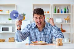The husband with loudspeaker yelling at his wife Stock Photos
