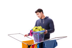 The husband man doing laundry isolated on white Stock Photography