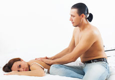 Husband massaging the back of his woman Royalty Free Stock Photos