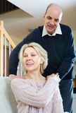 Husband massaging neck to wife Stock Photography