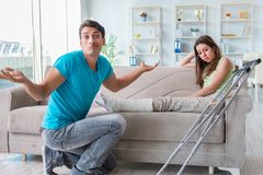The husband man supporting injured wife. Husband men supporting injured wife Stock Photo